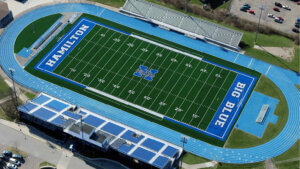 Artificial turf field and running track