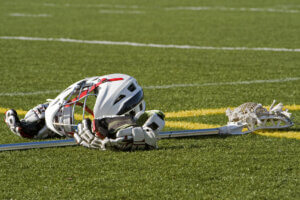 close u of sporting equipment laying on an artificial turf field